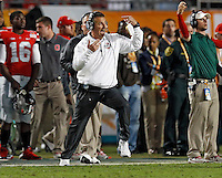 Ohio State Buckeyes head coach Urban Meyer yells at his players in the 2nd quarter of their game against Clemson Tigers in the Discover Orange Bowl at Sun Life Stadium in Miami Gardens, Florida on January 3, 2014.(Dispatch photo by Kyle Robertson)