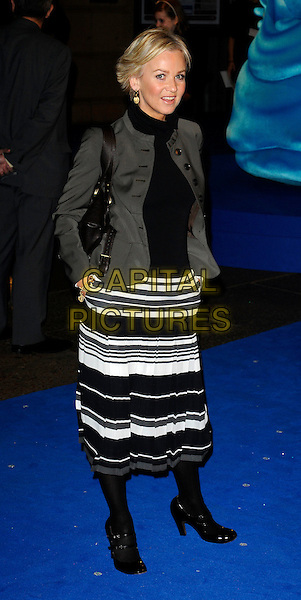 "LISA MAXWELL.""Monsters vs Aliens"" UK film premiere - arrivals, Vue West End cinema, Leicester Square, London, England..March 11th, 2009.full length grey gray jacket black white skirt striped stripes pleated pleats shoes tights polo neck double strap mary jane janes hands in pockets .CAP/CAN.©Can Nguyen/Capital Pictures."