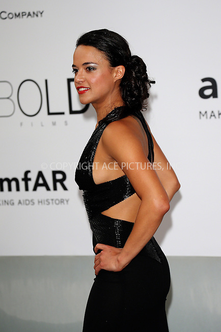 ACEPIXS.COM<br /> <br /> May 21 2014, Cannes<br /> <br /> Michelle Rodriguez arriving at amfAR's 21st Cinema Against AIDS Gala during the 67th Cannes International Film Festival at Hotel du Cap-Eden-Roc on May 21 2014 in Cap d'Antibes, France<br /> <br /> By Line: Famous/ACE Pictures<br /> <br /> ACE Pictures, Inc.<br /> www.acepixs.com<br /> Email: info@acepixs.com<br /> Tel: 646 769 0430