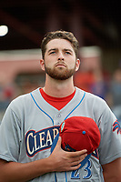 Clearwater Threshers pitcher Kyle Young (23) during the national anthem before a Florida State League game against the Dunedin Blue Jays on April 4, 2019 at Spectrum Field in Clearwater, Florida.  Dunedin defeated Clearwater 11-1.  (Mike Janes/Four Seam Images)
