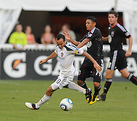 LA Galaxy midfielder Landon Donovan (10) shields the ball against DC Untied midfielder Andy Najar (14) . LA Galaxy defeated DC United 2-1 at RFK Stadium, Saturday July 18, 2010.