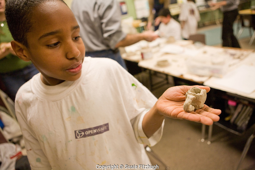 Building with clay in Tomas Oliva's Visual Art class at the YMCA CLC at Bailey Gatzert Elementary School.