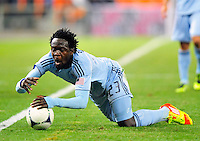 Sporting KC's Kei Kamara falls down while trying keep the ball inbound. Sporting Kansas City defeated D.C. United 1-0 during an MLS home opener at the RFK Stadium in Washington, D.C. on Saturday, March 10, 2012. Alan P. Santos/DC Sports Box