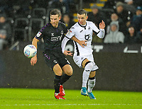 2nd January 2020; Liberty Stadium, Swansea, Glamorgan, Wales; English Football League Championship, Swansea City versus Charlton Athletic; Adam Matthews of Charlton Athleic and Bersant Celina of Swansea City jostle for the ball - Strictly Editorial Use Only. No use with unauthorized audio, video, data, fixture lists, club/league logos or 'live' services. Online in-match use limited to 120 images, no video emulation. No use in betting, games or single club/league/player publications