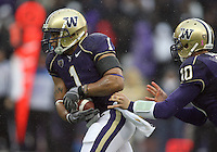 Oct 30, 20010:  Washington quarterback #10 Jake Locker hands the ball off to #1 Chris Polk against Stanford.  Stanford defeated Washington 41-0 at Husky Stadium in Seattle, Washington...