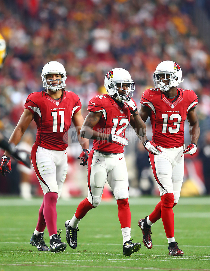 Dec 27, 2015; Glendale, AZ, USA; Arizona Cardinals wide receivers Larry Fitzgerald (11), John Brown (12) and Jaron Brown (13) in the first half against the Green Bay Packers at University of Phoenix Stadium. The Cardinals defeated the Packers 38-8. Mandatory Credit: Mark J. Rebilas-USA TODAY Sports
