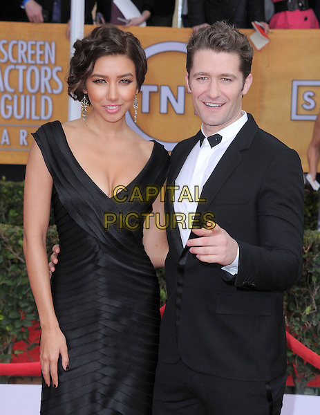 Renee Puente & Matthew Morrison.Arrivals at the 19th Annual Screen Actors Guild Awards at the Shrine Auditorium in Los Angeles, California, USA..27th January 2013.SAG SAGs half length black white dress shirt tuxedo couple hand finger pointing .CAP/DVS.©DVS/Capital Pictures.