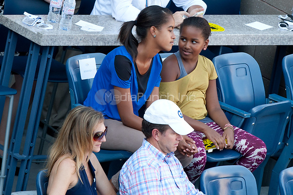 NEW YORK, NY - SEPTEMBER 09: First Lady Michelle Obama attends the 2011 US Open at USTA Billie Jean King National Tennis Center on September 9, 2011 in New York City<br /> <br /> <br /> People:  Malia Obama_Sasha Obama<br /> <br /> Transmission Ref:  MNC<br /> <br /> Hoo-Me.com / MediaPunch