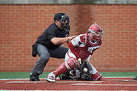 Arkansas Razorbacks catcher Grant Koch (33) blocks a low pitch as home plate umpire Brent Cardwell looks on during the game against the Charlotte 49ers at Hayes Stadium on March 21, 2018 in Charlotte, North Carolina.  The 49ers defeated the Razorbacks 6-3.  (Brian Westerholt/Four Seam Images)