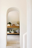 Fresh organic products from the vegetable garden are stored in this contemporary larder