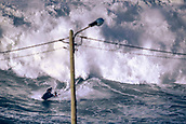 6th January 2018, Praia do Norte, Nazaré , Portugal;  Unidentified Pro surfer is rescued by a jetski when attempting to catch a wave