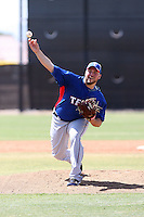 Tommy Hunter of the Texas Rangers pitches in an extended spring training game against the Seattle Mariners at the Mariners complex on April 30, 2011  in Peoria, Arizona. Hunter was coming back from an injury in preparation for returning to the major league rotation..Photo by:  Bill Mitchell/Four Seam Images.