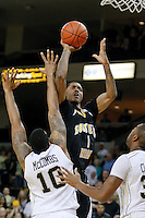 February 26, 2011: Southern Miss guard Maurice Bolden (1) shoots over Central Florida forward Dwight McCombs (10) during first half mens Conference USA NCAA basketball game action between the Southern Miss Golden Eagles and the Central Florida Knights at the UCF Arena in Orlando, Fl..