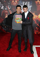 LOS ANGELES, CA - NOVEMBER 13: Mario Lopez, Ezra Miller, at the Justice League film Premiere on November 13, 2017 at the Dolby Theatre in Los Angeles, California. <br /> CAP/MPI/FS<br /> &copy;FS/MPI/Capital Pictures