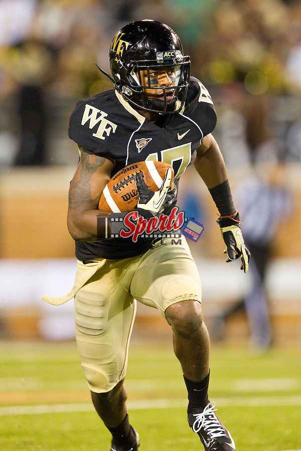 A.J. Marshall (17) of the Wake Forest Demon Deacons returns an interception for a touchdown during second half action against the Liberty Flames at BB&T Field on September 1, 2012 in Winston-Salem, North Carolina.  The Demon Deacons defeated the Flames 20-17.  (Brian Westerholt/Sports On Film)