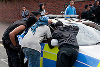 Supporters of the English Defence League hold a protest in Dudley. There was a counter protest by Unite Against fascism and local Muslim Youths. Both sides were involved in scuffles with Police.