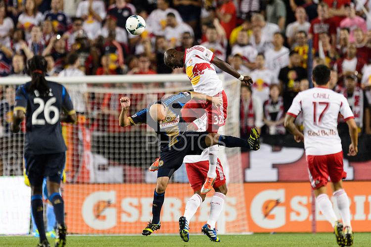 Ibrahim Sekagya (32) of the New York Red Bulls goes up for a header with Conor Casey (6) of the Philadelphia Union. The New York Red Bulls and the Philadelphia Union played to a 0-0 tie during a Major League Soccer (MLS) match at Red Bull Arena in Harrison, NJ, on August 17, 2013.
