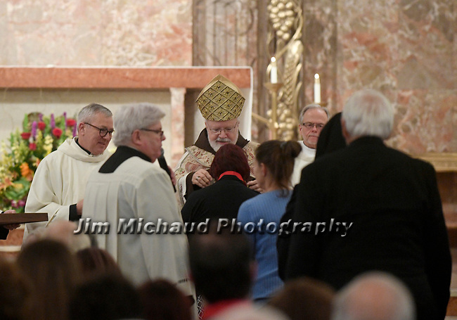MALDEN MA NOVEMBER25: Cardinal Sean O'Malley puts the award around the neck of winner of the  Cheverus award, one of 125 recipients, Sunday, November 25, 2018, at the Immaculate Conception Church in Malden. (Herald Photo by Jim Michaud)