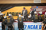 ADRIAN, MI - MARCH 18: Head coach Chad Davis of Adrian College speaks with his players during the Division III Women's Ice Hockey Championship held at Arrington Ice Arena on March 19, 2017 in Adrian, Michigan. Plattsburgh State defeated Adrian 4-3 in overtime to repeat as national champions for the fourth consecutive year. by Tony Ding/NCAA Photos via Getty Images)