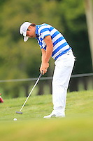 Hideto Tanihara (JPN) putts on the 1st green during Thursday's Round 1 of the 2014 PGA Championship held at the Valhalla Club, Louisville, Kentucky.: Picture Eoin Clarke, www.golffile.ie: 6th August 2014