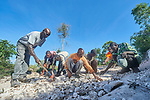 Residents work together to repair their rocky roads in Picmy, a village on the Haitian island of La Gonave, where Service Chr&eacute;tien d&rsquo;Ha&iuml;ti is working with survivors of Hurricane Matthew, which struck the region in 2016.<br /> <br /> SCH, a member of the ACT Alliance, supports the road building as a critical element of helping the local economy recover from the hurricane. Better roads mean farmers can more quickly get their crops to market, and make life easier on women and children who often have to travel long distances to fetch water.