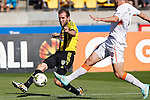 Phoenix's Jeremy Brockie, left, takes a shot past Brisbane Roar's James Donachie, right, in the A-League football match at Westpac Stadium, Wellington, New Zealand, Sunday, January 04, 2015. Credit: Dean Pemberton