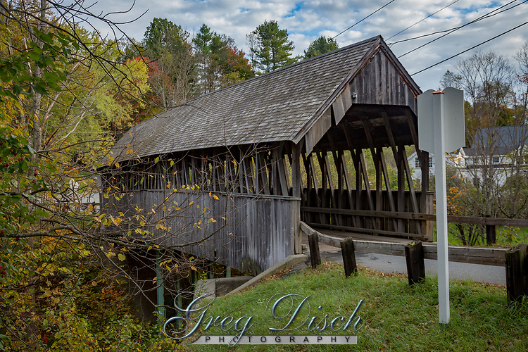 The Meriden Bridge, also called the Mill Bridge, is a historic covered bridge in the Meriden area of Plainfield, New Hampshire. The bridge is a single span which carries Colby Hill Road over Bloods Brook, just west of a junction with Main Street and Willow Brook Road.<br /> <br /> The current bridge is the third one on this site. The previous two were open timber structures. The present bridge was built by James Tasker for a fee of $465. Levi Sanderson was paid $220 for building the bridge abutments. After being damaged by Hurricane Carol on August 30, 1954, it was repaired at a cost of $3,000. In 1963, the bridge was rebuilt and steel beams were introduced to carry a load of fifteen tons. This is thought to be the first covered bridge in New Hampshire to be repaired under the state's Town Bridge Aid program. In the spring 1977, heavy snows caused the roof to cave in. The repairs cost $8,296. In 1985, the state repaired the substructure for $57,000. The bridge is also know as Mill Bridge. The Meriden Bridge is listed on the National Register of Historic Places.