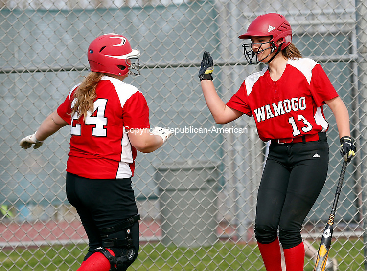 Litchfield, CT- 06 May 2015-050615CM08-  Wamogo's Cyrena Zemaitis, right, congratulates teammate Malia Rebot after Rebot drove in three runs against Northwestern in Litchfield in Wednesday.   Christopher Massa Republican-American