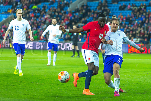 29.03.2016  Ullevaal Stadion, Oslo, Norway. Adama Diomande of Norway in pursuit of the ball against Ville Jalasto of Finland during the International Football Friendly match  between Norway and Finland at the Ullevaal Stadion in Oslo, Norway.  Norway ran out 2-0 winners of the game.
