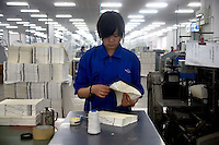 "An Amity Printing Company employee binds Bible pages in the Amity Printing Company's new printing facility in Nanjing, China...On May 18, 2008, the Amity Printing Company in Nanjing, Jiangsu Province, China, inaugurated its new printing facility in southern Nanjing.  The facility doubles the printing capacity of the company, now up to 12 million Bibles produced in a year, making Amity Printing Company the largest producer of Bibles in the world.  The company, in cooperation with the international organization the United Bible Societies, produces Bibles for both domestic Chinese use and international distribution.  The company's Bibles are printed in Chinese and many other languages.  Within China, the Bibles are distributed both to registered and unregistered Christians who worship in illegal ""house churches."""