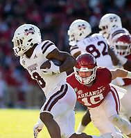 Mississippi State Bulldogs vs Arkansas Razorback - Arkansas  Sophmore Bumper Pool (10) <br />goes in for the tackle of Mississippi State's Kylin Hill (8) <br /> at Donald W. Reynolds Stadium, Fayetteville, on Saturday, November 2, 2019 / Special to NWA Democrat Gazette David Beach