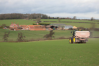 Farmstead with a tractor working in the field <br /> &copy;Tim Scrivener Photographer 07850 303986<br />      ....Covering Agriculture In The UK....