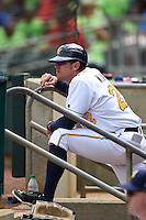 Montgomery Biscuits manager Brady Williams (22) watches from the dugout during a game against the Mississippi Braves on April 22, 2014 at Riverwalk Stadium in Montgomery, Alabama.  Mississippi defeated Montgomery 6-2.  (Mike Janes/Four Seam Images)