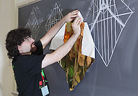 New York, NY, USA - June 26, 2011: Mike Assis, original Origami designer at the OrigamiUSA Convention in New York City teaching one of his complex creations, an organist, folded from one square of paper without cuts.