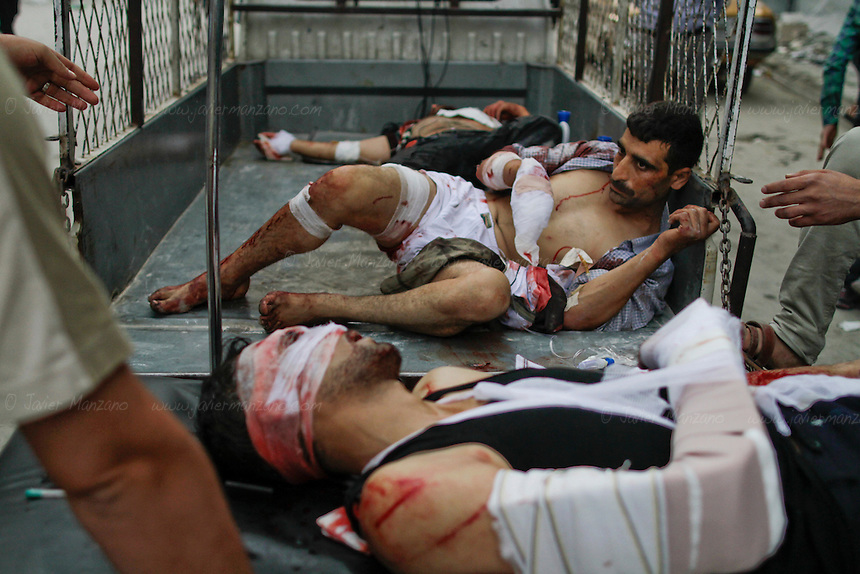 Civilians, injured by mortar shells, are treated at a local clinic in the heart of Aleppo city on Wednesday, October 10, 2012. ..© Javier Manzano