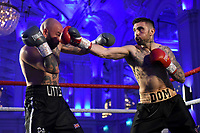 Domenic Specchio (R) defeats Danny Little during a Boxing Show at The Devere Grand Connaught Rooms on 9th May 2019