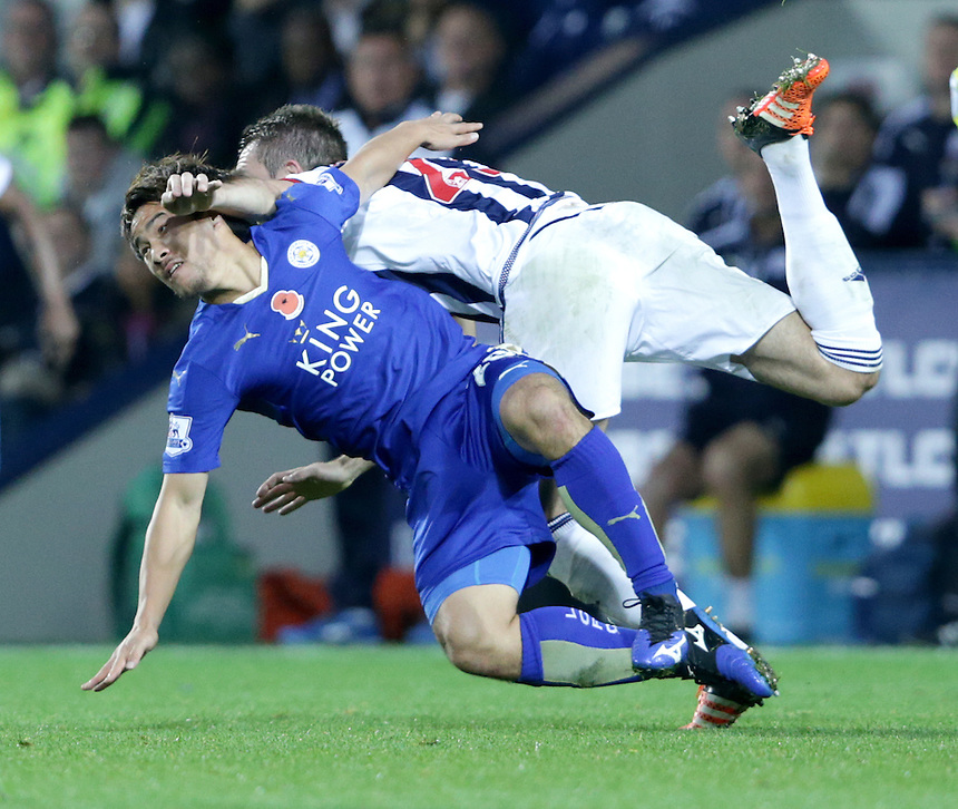 Leicester City's Shinji Okazaki tackled by West Bromwich Albion's Craig Dawson during todays match<br /> <br /> Photographer Rachel Holborn/CameraSport<br /> <br /> Football - Barclays Premiership - West Bromwich Albion v Leicester City - Saturday 31st October 2015 - The Hawthorns - West Bromwich<br /> <br /> &copy; CameraSport - 43 Linden Ave. Countesthorpe. Leicester. England. LE8 5PG - Tel: +44 (0) 116 277 4147 - admin@camerasport.com - www.camerasport.com