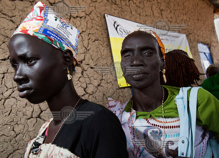 People queue to vote at a polling station in Malakal, South Sudan. On 9th January 2011 Southern Sudan's people voted in a referendum on whether to become independent from the North..