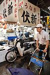 Tokyo, June 25 2013 -Gross seller at tsukiji fish market.
