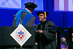 Lawrence Hamer, right, receives the Lawrence R. Ryan Teaching Award from Ray Whittington, dean of the Driehaus College of Business, Sunday, June 11, 2017, during the DePaul University Driehaus College of Business commencement ceremony at the Allstate Arena in Rosemont, IL. (DePaul University/Jamie Moncrief)