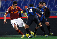 Calcio, semifinale di andata di Coppa Italia: Roma vs Inter. Roma, stadio Olimpico, 23 gennaio 2013..AS Roma midfielder Marquinho, of Brazil, left, is challenged by FC Inter defender Javier Zanetti, of Argentina, center, and midfielder Walter Gargano, of Uruguay, during the Italy Cup football semifinal first half match between AS Roma and FC Inter at Rome's Olympic stadium, 23 January 2013..UPDATE IMAGES PRESS/Isabella Bonotto