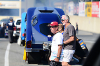 Oct. 5, 2012; Mohnton, PA, USA: NHRA fans walk through the staging lanes past top alcohol funny car drivers during qualifying for the Auto Plus Nationals at Maple Grove Raceway. Mandatory Credit: Mark J. Rebilas-
