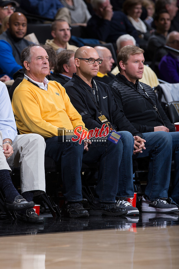 PGA professional golfers and former Wake Forest Demon Deacons Jay Haas (left) and his son Bill Haas take in the men's basketball game against the Minnesota Golden Gophers at the LJVM Coliseum on December 2, 2014 in Winston-Salem, North Carolina.  The Golden Gophers defeated the Demon Deacons 84-69. (Brian Westerholt/Sports On Film)