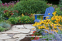 63821-21907 Flower garden with blue Adirondack chair and stone path.  Black-eyed Susans (Rudbeckia hirta) Red Dragon Wing Begonias, Russian Sage (Perovskia atriplicifolia)  Raspberry Wine Bee Balm (Monarda didyma) zinnias, Marion Co., IL