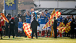 Rangers captain Lee Wallace leads the teams out