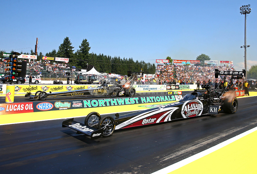 Aug. 3, 2014; Kent, WA, USA; NHRA top fuel dragster driver Shawn Langdon (near) races alongside teammate Khalid Albalooshi during the Northwest Nationals at Pacific Raceways. Mandatory Credit: Mark J. Rebilas-USA TODAY Sports