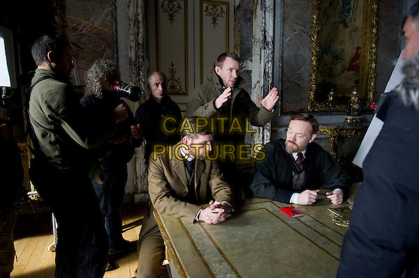 Director GUY RITCHIE and JARED HARRIS .on the set of Sherlock Holmes: A Game of Shadows.*Filmstill - Editorial Use Only*.CAP/FB.Supplied by Capital Pictures.