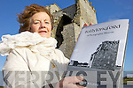 MEMOIR: Nancy McAuliffe pictured at Carrigafoyle Castle with her new photographic memoir of Ballylongford.