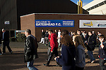 Fans making their way out of the Gateshead International Stadium, the athletics stadium which is also the home ground of Gateshead FC, as the club play host to Cambridge United in a Blue Square Bet Premier division fixture. The match ended in a one-all draw, watched by a crowd of 904. The point meant Gateshead went to the top of the division, one below the Football League in England.