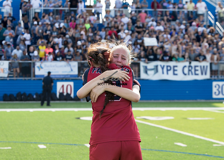 Tompkins Falcons JoAnnie Ramos (9) and Skylar Parker (22) share a moment following a loss in the Class 6A UIL girls soccer state final between the Pflugerville Hendrickson Hawks and the Katy Tompkins Falcons at Birkelbach Field in Georgetown, Texas, on April 15, 2017. Hendrickson won 2-0.